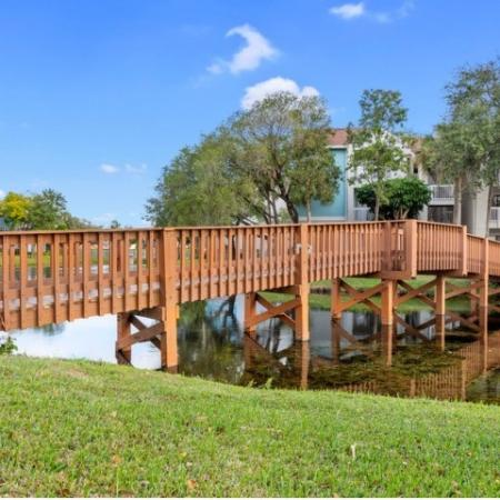 100 foot red wood bridge that takes you from the leasing office over the lake to the first section of apartment homes.