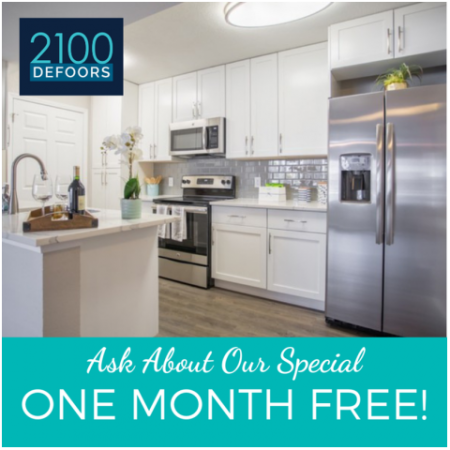 Offering Special of One Month Free  Modern Photo of Kitchen with white shaker cabinets with updated hardware package, modern lighting package, stainless steel appliances, quartz countertops and plank inspired flooring