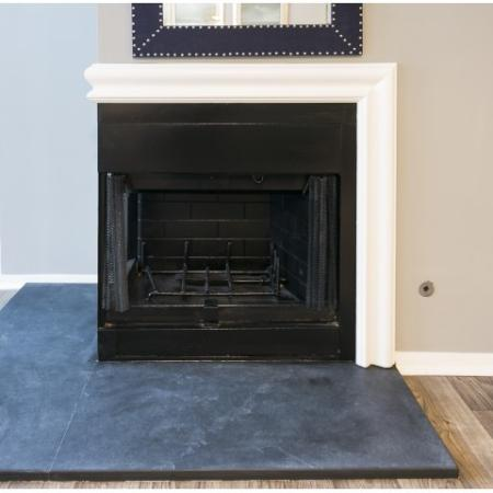 Unique corner wood burning fireplace