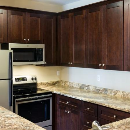 kitchen with granite countertops and microwave