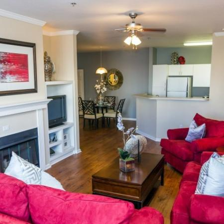 interior model home with fireplace and large couches