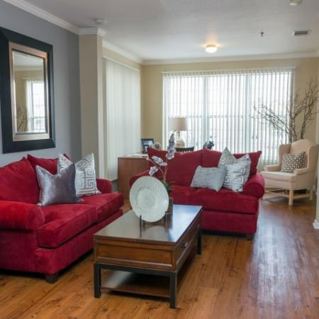 model home living room with large couches and coffee table