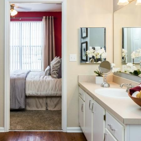 bathroom with large countertop connected to bedroom