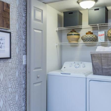 Alvista Sterling Palms view of laundry closet with full size washer and dryer