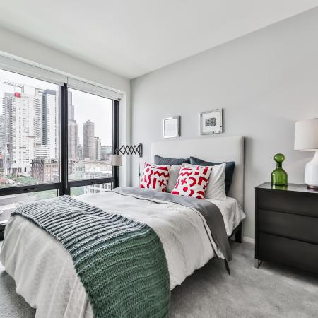 Fully furnished bedroom with city view