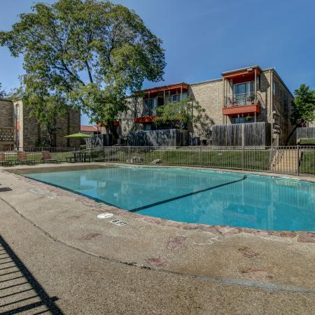Swimming Pool surrounded by Oak Terrace apartment community
