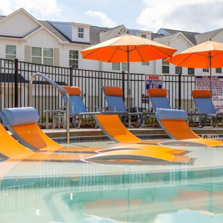 Pool and pool chairs with umbrellas