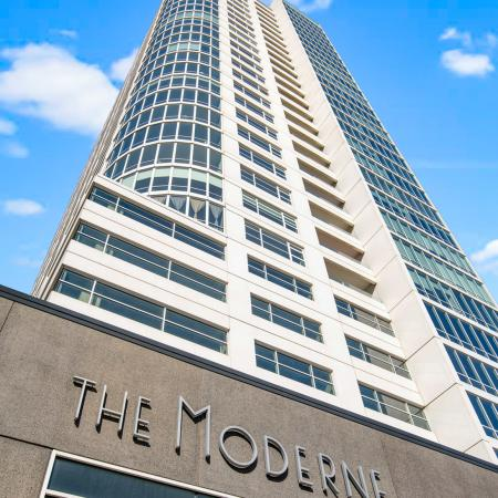 The sky view of The Moderne building and sign