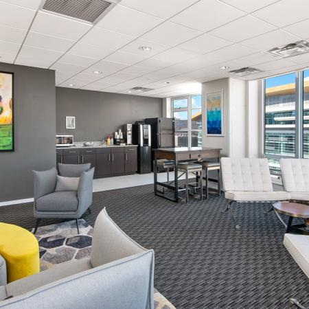 Furnished media and party room featuring a complimentary coffee bar
