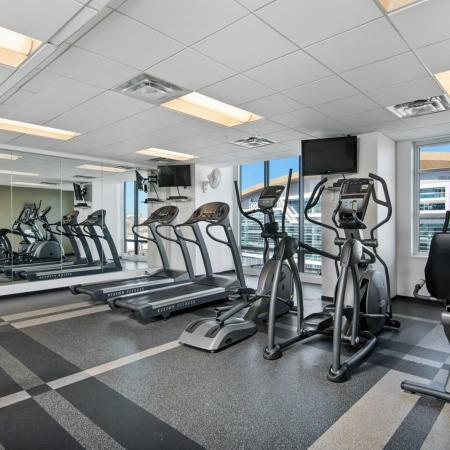 24-hour fitness center with city views and exercise equipment