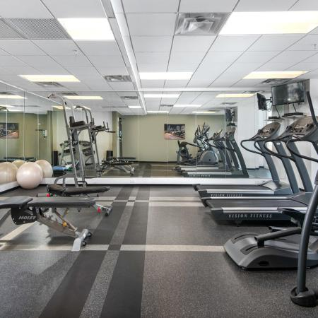 24-hour fitness center with city views, floor-to-ceiling mirrors and exercise equipment