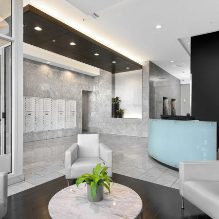 Furnished lobby with an on-site service concierge desk, storage lockers and high speed elevators