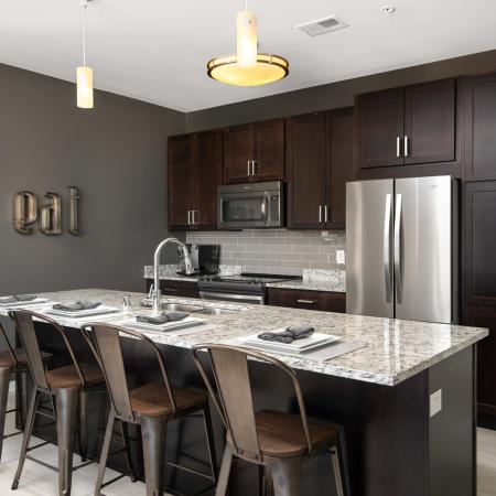 Modern kitchen with stainless steel appliances and granite countertops