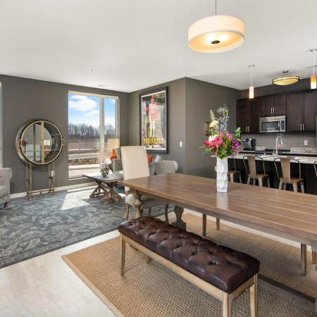 Open concept modern kitchen, dining area and family room