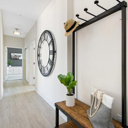 Hallway with coat stand and clock