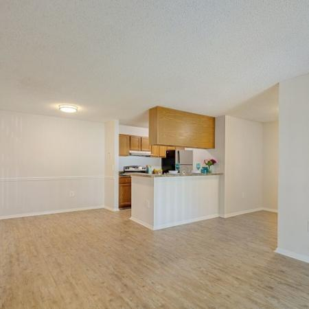 Newly renovated with light wood flooring, granite like cabinets and black appliance package .