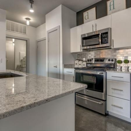 Gorgeous eat in kitchen with stainless steel appliances.