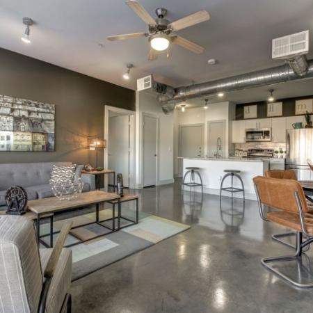 Beautiful open floor plans with eat in kitchen and concrete floors.
