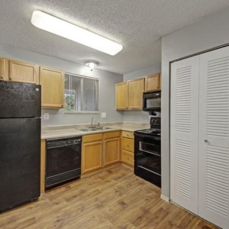 hunters way Jacksonville kitchen with black appliances and wood cabinetry