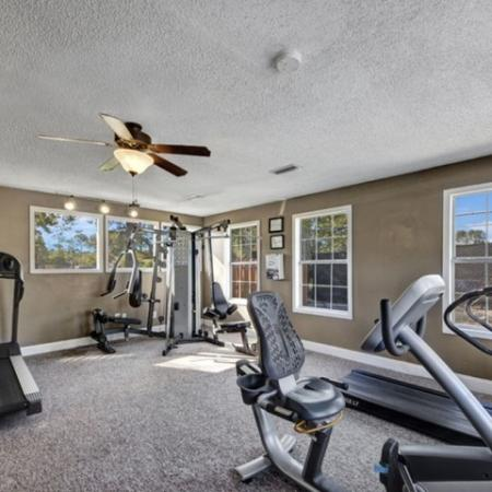 hunters way Jacksonville fitness center with treadmills, weight equipment and bike