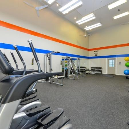 Fitness Center with tread mill, free weights and ellipticals