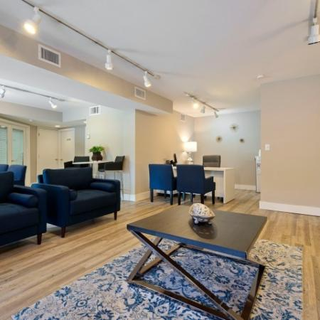Furnished leasing office with sitting area and desks
