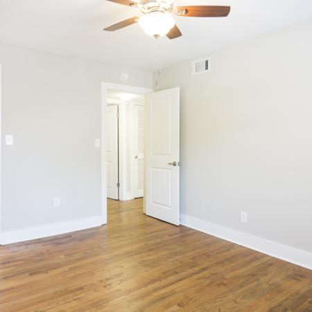Bedroom with plank flooring and light grey walls