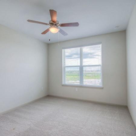 San Mateo Apartments Kissimmee Florida bedroom with carpet, ceiling fan