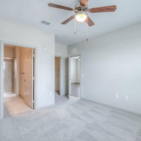 San Mateo Apartments Kissimmee Florida bedroom with carpeting, ceiling fan