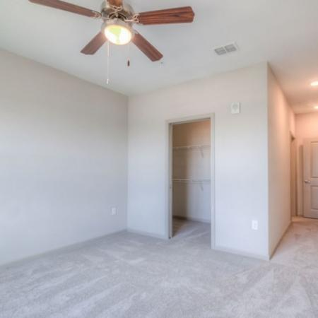 San Mateo Apartments Kissimmee Florida bedroom with carpet, walk in closet, ceiling fan