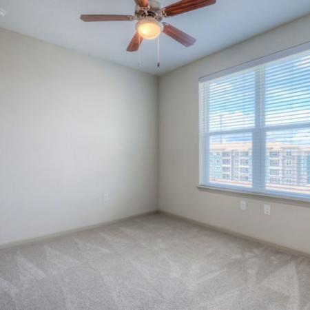 San Mateo Apartments Kissimmee Florida bedroom with carpet and ceiling fan