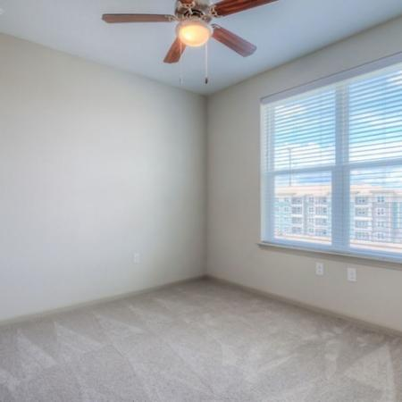 San Mateo Apartments Kissimmee Florida bedroom with carpet & ceiling fan