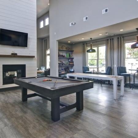 Clubroom with a pool table and shuffleboard