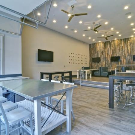 Sports lounge with seating and garage doors