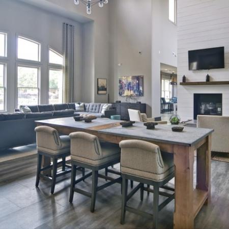 Community working table and space in the clubroom with Fireplace