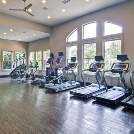 Cardio equipment in the fitness center overlooking the pool area