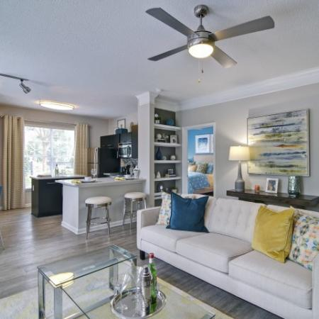 Open Concept floor plan apartment with faux wood floors,  quartz countertops and stainless steel appliances