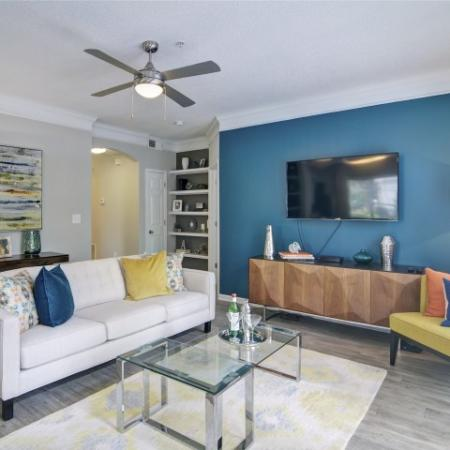 Open Concept floor plan apartment with built in book shelves and space for wall mounted television