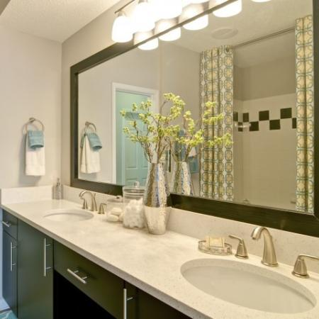 Large double vanity in the bathroom with a framed mirror