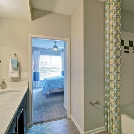 Tiled shower in the bathroom with garden tub combined shower