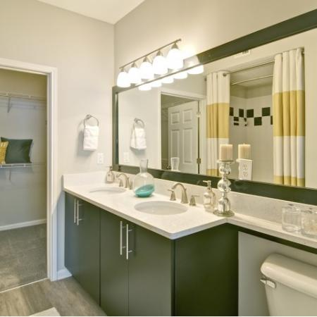 Bathroom with Double Vanity and framed mirror and brushed nickle hardware