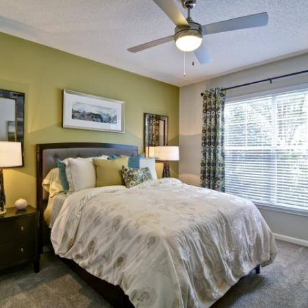 Bedroom with carpet, ceiling fan and room for a king size bed