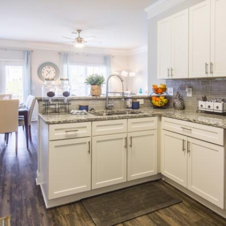 Brand New Beautiful Kitchen with Dallas White Cabinetry, Brushed Nickel Hardware and Faux Wood Flooring