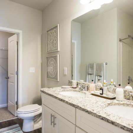Large Double Vanity in the bathroom with walk-in closet