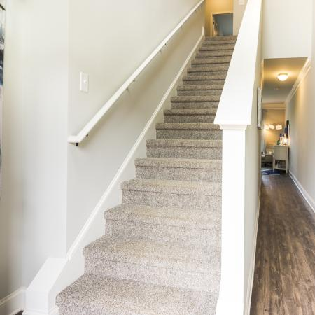 Carpeted Stairs leading to upstairs living space