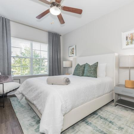 Beautifully decorated bedroom, modern bedroom, ceiling fan with light and wood inspired flooring