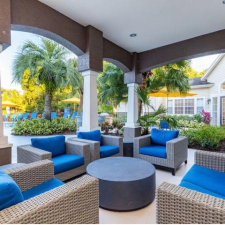 Alvista Sterling Palms outdoor deck by swimming pool with seating area