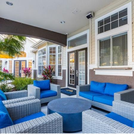 Alvista Sterling Palms outdoor deck outside clubhouse by swimming pool with seating area