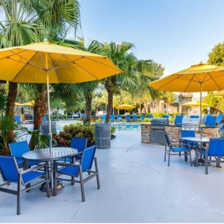 Alvista Sterling Palms outdoor pool deck with grilling and seating area