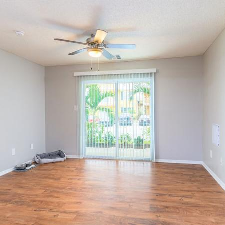 Unfurnished living room with ceiling fan and hardwood style flooring